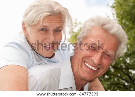 nice elderly couple on the nature