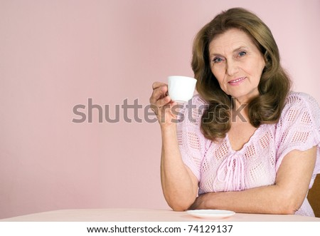 nice elderly woman on a pink background