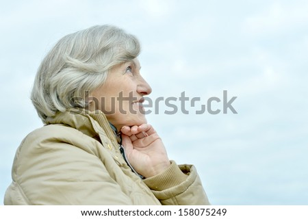nice elderly woman walking in the park alone