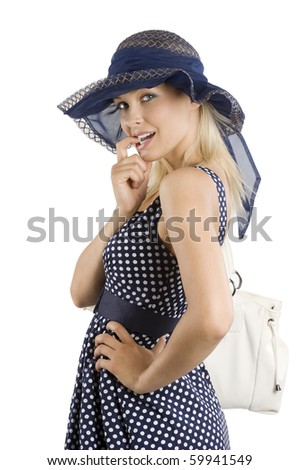 nice elegant woman in blue in act to biting her finger and looking in camera with expressive eyes