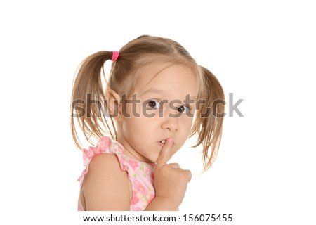 Nice emotional little girl on white background. Showing hush sign