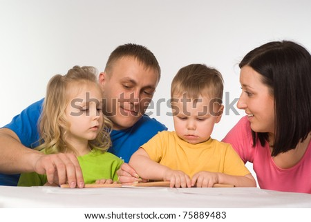 nice family drawing on the table on white