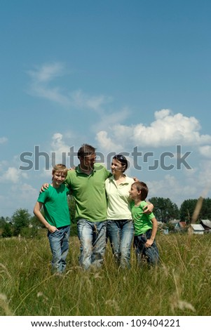 Nice family having fun in the company of each other on the nature