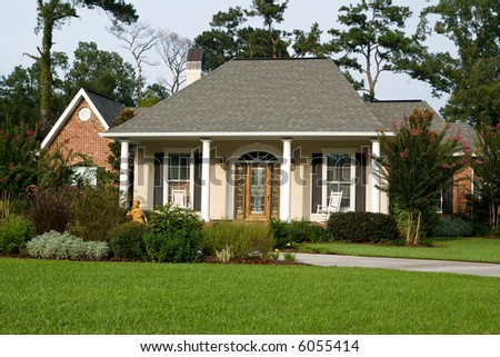 nice family home with lush landscaping - stock photo