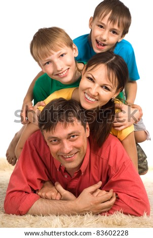 nice family of a four on a carpet