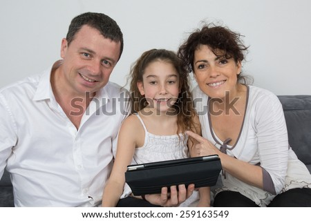 Nice family of three , parents and their girl