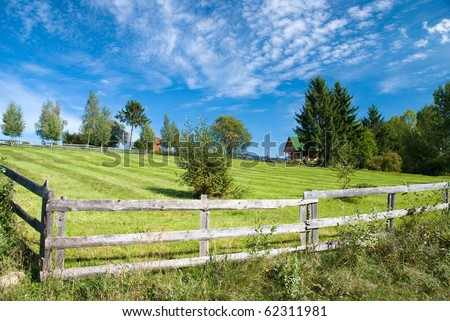 Nice farm in countryside Romania - stock photo