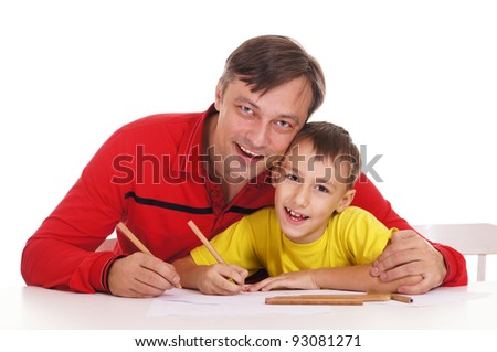 nice father drawing with son at table