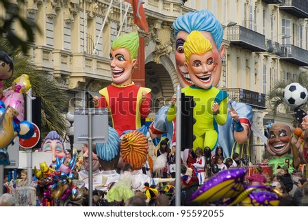 """NICE - FEBRUARY 19: A float is on display during the Carnival of Nice on February 19, 2012 on the French Riviera, Nice, France. This is the main winter event of the Riviera. The 2012 topic is the """"King of Sport"""". A reference to the London Olympics. - stock photo"""