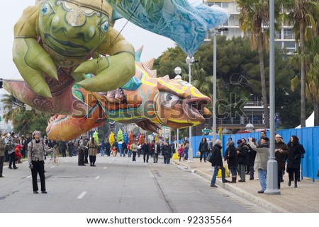 """NICE - FEBRUARY 27: Carnival of Nice on February 27, 2011 in French Riviera. This is the main winter event of the Riviera. 2011 theme is the """"King of Mediterranean Sea"""". - stock photo"""