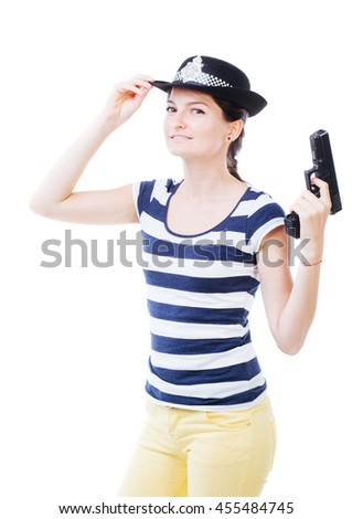 Nice female holding a gun and posing as policewoman - stock photo