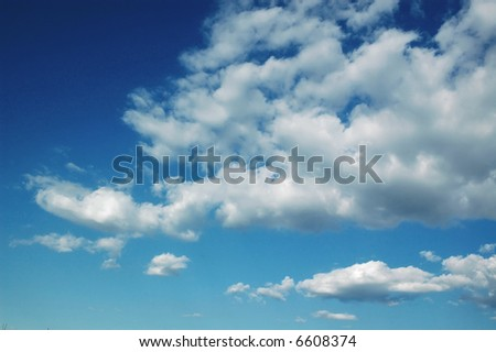 Nice fluffy clouds. - stock photo