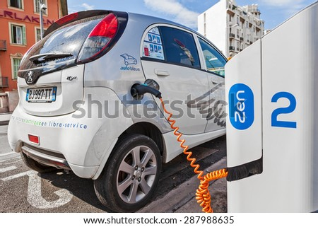 NICE, FRANCE - AUGUST 23, 2014: Electric car at Auto Bleue charging station - popular urban self service car sharing service in Nice with more than sixty stations and over 200 electric vehicles. - stock photo