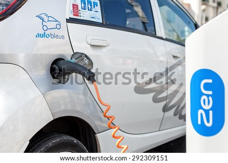 NICE, FRANCE - AUGUST 23, 2014: Electrical car at Auto Bleue charging station - popular urban self service car sharing service in Nice with more than sixty stations and over 200 electric vehicles. - stock photo