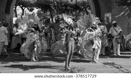 NICE, FRANCE - CIRCA AUGUST 2006: Girls at Brazilian carnival in black and white