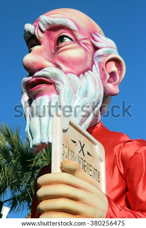 Nice, France - February 21 2016: Caricature of Moses and The Ten Commandments (Prophet). Parade Float during the Carnival of Nice in French Riviera. The Theme for 2016 was King of Media - stock photo