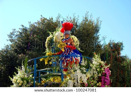 NICE, FRANCE - FEBRUARY 22: Carnival of Nice, Flowers' battle. This is the main winter event of the Riviera. The artist dressed in the costume of French flag colors. Nice, France - Feb 22, 2012 - stock photo