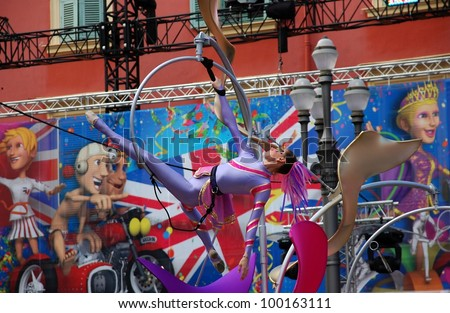 NICE, FRANCE - FEBRUARY 21: Carnival of Nice in French Riviera. This is the main winter event of the Riviera. 2012 theme is the King of Sport. Young woman gymnast Nice, France - Feb 21, 2012 - stock photo