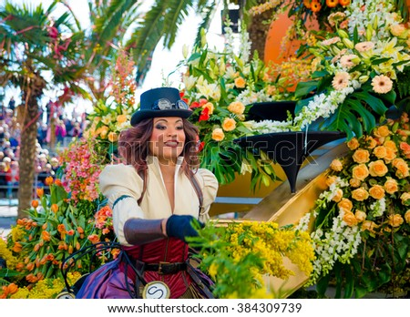 Nice, France - February 20, 2016: Participants in the carnival parade Battle of Flowers in Nice, Carnaval de Nice, Roi de Media - stock photo