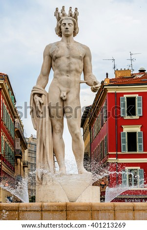 NICE, FRANCE - JULY 7, 2014: Famous fountain du Soleil with the Apollo statue (by Alfred Auguste) on Place Massena. French Riviera. - stock photo