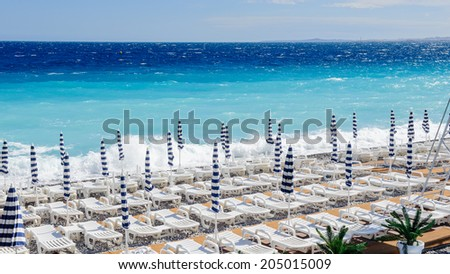 NICE, FRANCE - JUNE 25, 2014: Beach of the Mediterranean sea, Cote d Azur,Nice, France. Nice is the capital of the Alpes Maritimes departement - stock photo
