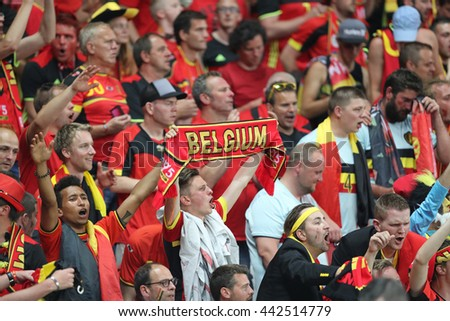NICE, FRANCE - JUNE 22, 2016: Belgian fans show their support during the UEFA EURO 2016 game Sweden v Belgium at Allianz Riviera Stade de Nice, Nice, France. Belgium won 1-0 - stock photo