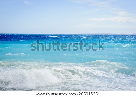 NICE, FRANCE - JUNE 25, 2014: Mediterranean sea, Cote d Azur,Nice, France. Nice is the capital of the Alpes Maritimes departement - stock photo
