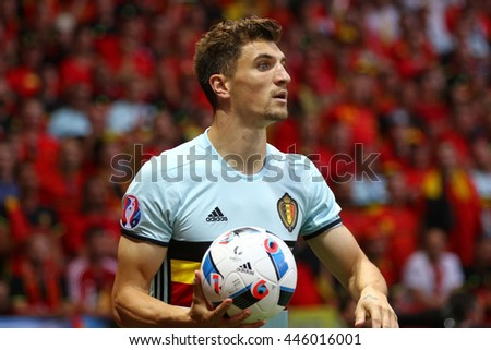 NICE, FRANCE - JUNE 22, 2016: Thomas Meunier of Belgium throws in the ball during UEFA EURO 2016 game against Sweden at Allianz Riviera Stade de Nice, City of Nice, France. Belgium won 1-0 - stock photo