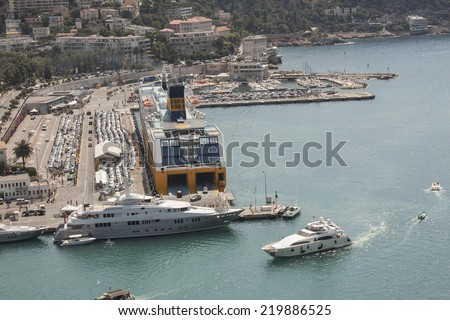 """NICE, France, JUNE 28, 2014 : view of the harbor """"Lympia"""" from Castle Hill arriving at the ferry company """"Corsica Sardinia Ferries' , Cote d'Azur - stock photo"""