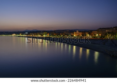 NICE, FRANCE - MARCH 13, 2014: The city comes to life in the evening on the Promenade des Anglais,  Les Ponchettes and market area of Cours Saleya.