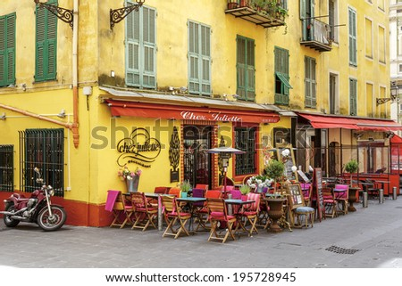NICE, FRANCE - MAY 21, 2014: Chez Juliette Restaurant invites in the Old Town, it shows the lifestyle and architecture detail of historic part of the city  - stock photo