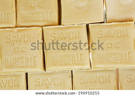 NICE, FRANCE - MAY 18, 2014: Marseille soap also called Savon de Marseille, put up for sale at the market, traditional soap made from vegetable oils, under the same name produces for about 600 years - stock photo