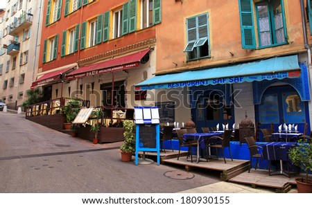 NICE, FRANCE - MAY 14, 2013: Multicolored houses and oriental ethnic restaurants in the Old town Nice - the largest resort and tourist town on the French Riviera, Cote d'Azur, France. - stock photo
