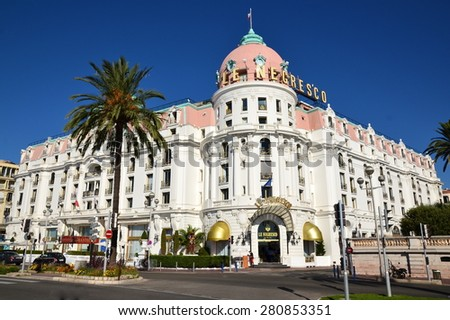 NICE, FRANCE-MAY 23: Negresco palace facade shown on may 23, 2015 in Nice city, France. Negresco hotel is a luxury hotel containing 121 rooms and 21 suites, located in the famous carnival town. - stock photo