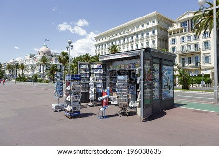 NICE, FRANCE - MAY 13, 2014: Newsstand offers the latest newspapers and magazines on the Promenade des Anglais, favorite place of recreation at the seven kilometers along the coast of the Cote d'Azur  - stock photo