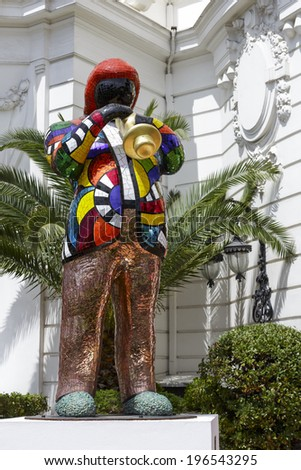 NICE, FRANCE - MAY 16, 2014:  Statue of Miles Davis by French sculptor, painter, and film maker Niki de Saint Phalle, 1999, set in front of famous and luxury hotel Negresco Hotel - stock photo