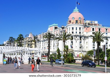 NICE, FRANCE - MAY 16: The famous Le Negresco Hotel on May 16, 2015 in Nice, France. This historic luxury hotel, located in the Promenade des Anglais, is a landmark in the city - stock photo