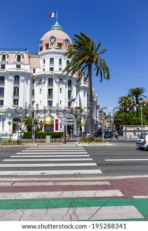 NICE, FRANCE - MAY 16, 2014: The Hotel Negresco, first opened in 1913 facing the Mediterranean sea, famous and luxury hotel offers 96 rooms and 21 suites, view from  the pedestrian crossing