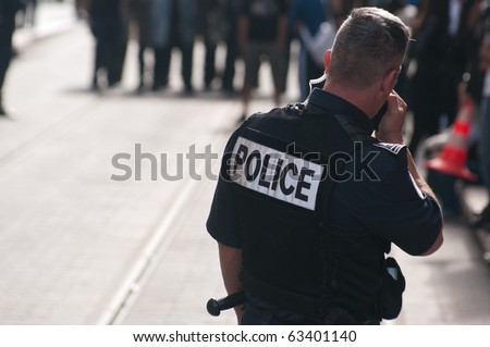 NICE, FRANCE - OCTOBER 16: French police control the street of nice during a  student  protest against school reform proposed by the french government, Nice the 16 of october 2010, France - stock photo