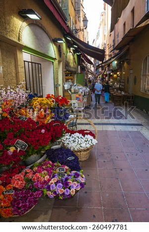 NICE, FRANCE - OCTOBER 2, 2014: Walking pedestrian Rue Pairoliere, a quaint shopping street lined with food shops and cafes, is a great way to experience authentic Nice. - stock photo
