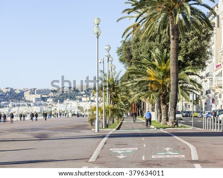 NICE, FRANCE, on JANUARY 13, 2016. A bicycle path on Promenade des Anglais. Winter day.