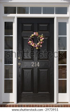 Nice front door of house from exterior view - stock photo