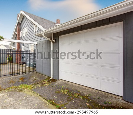 Nice garage with white door, and black gate.