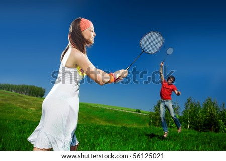 Nice girl and boy with rackets - stock photo