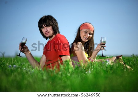 Nice girl and boy with wineglasses - stock photo