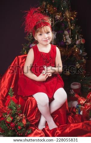 nice girl at a New Year tree  - stock photo