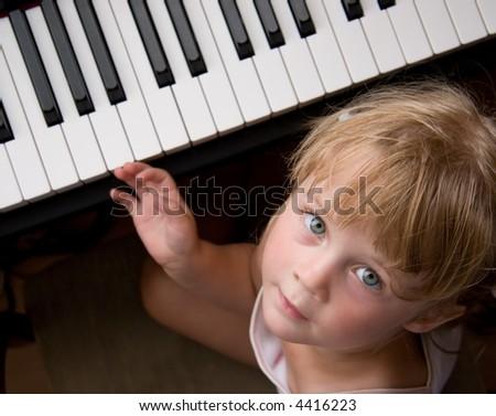 nice girl at digital piano - stock photo