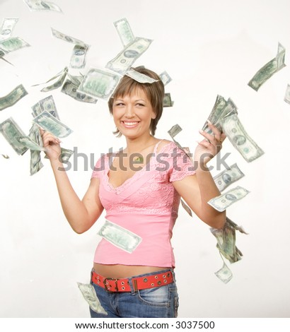 Nice girl catching falling dollars - stock photo