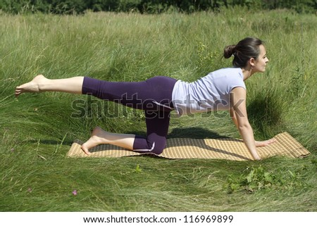 nice girl doing gymnastics in the summer park - stock photo