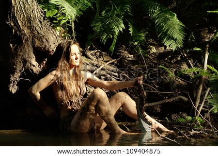 Nice girl explores the savage jungle in search of prey - stock photo